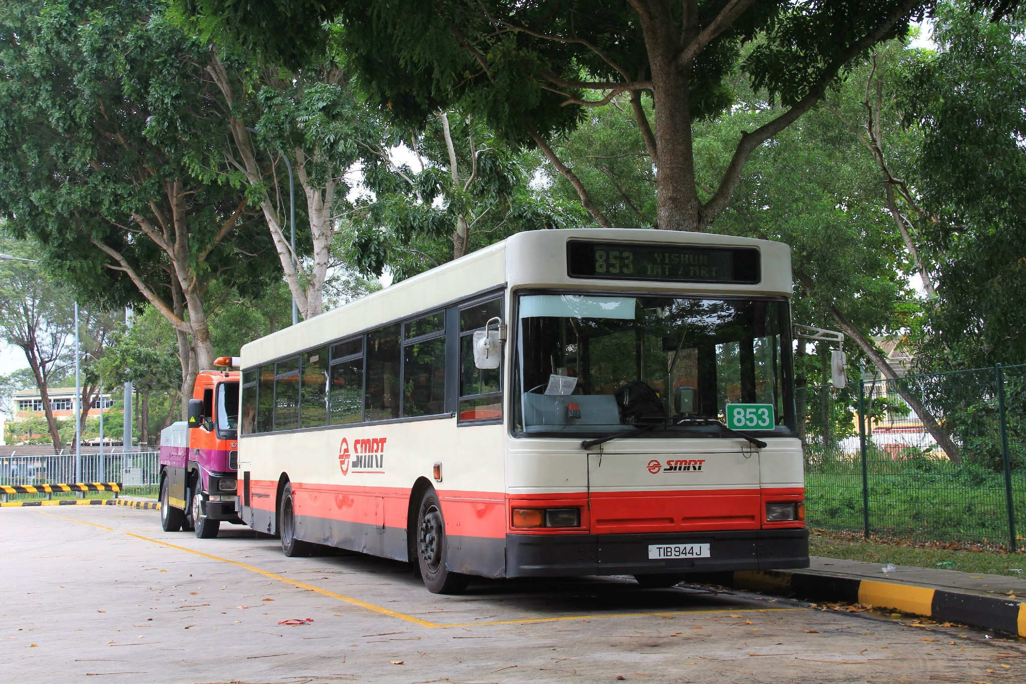 SMRT buses park at a corner of the interchange.