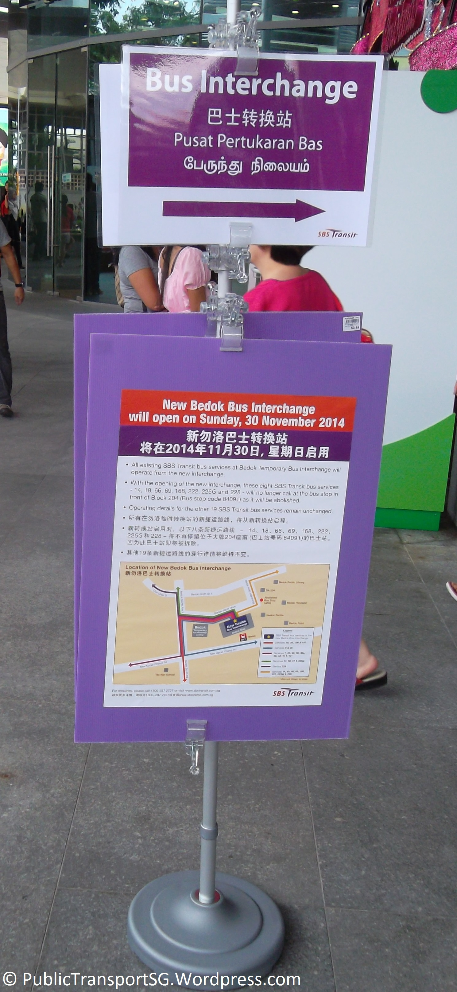 Signboard directing passengers to the new Bedok Bus Interchange