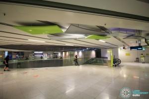 Walk from lift landing (far background) and enter station via escalator