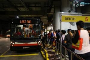 Passengers boarding the last Bus 900 trip from Woodlands Regional Bus Interchange