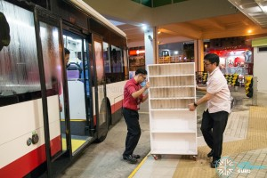 SMRT staff using a bus to move out old furniture
