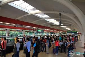 Tanah Merah MRT Station - Crowded platform waiting for Changi Airport-bound train