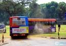 SMRT Bendy Bus stuck in field