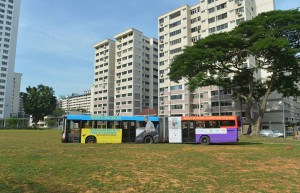 SMRT Bus stuck in the field. ST PHOTO: ALPHONSUS CHERN