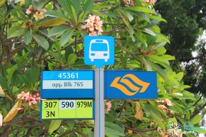 Estate bus stop sign in Lush Green