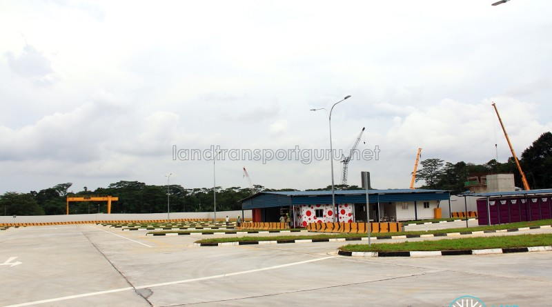 Seletar Bus Depot (Bus Park), with container offices under a metal roof and portable toilets