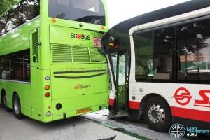 Side view of accident. The front door of the SMRT bus has been knocked out of position.