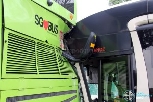 The left mirror of the SMRT bus bent backwards, and damage to the air conditioning grill of the SBS Transit bus