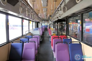 Front to rear view. Seats near the aisle are in purple, while seats nearer to the windows are in blue.
