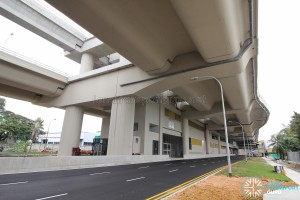 Tuas Crescent MRT Station - View from street level (Pioneer Road), with tracks running above the road viaduct