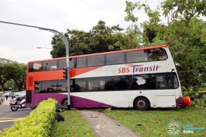 Side view of accident bus, with damaged panels evident