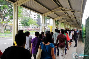 Commuters at Ang Mo Kio queuing for the Rail Bridging Bus service