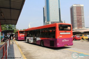 Kotaraya Bus Terminal - SBS Transit buses parking next to the dispatcher's shelter and passenger waiting area