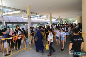 Commuters queue for Shuttle 7 at Aljunied during the Full Day Closure