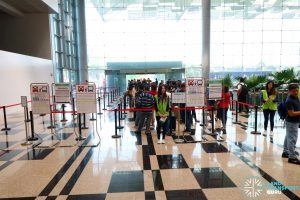 Queues for Shuttle 8 and Express 12 at Changi Airport T3