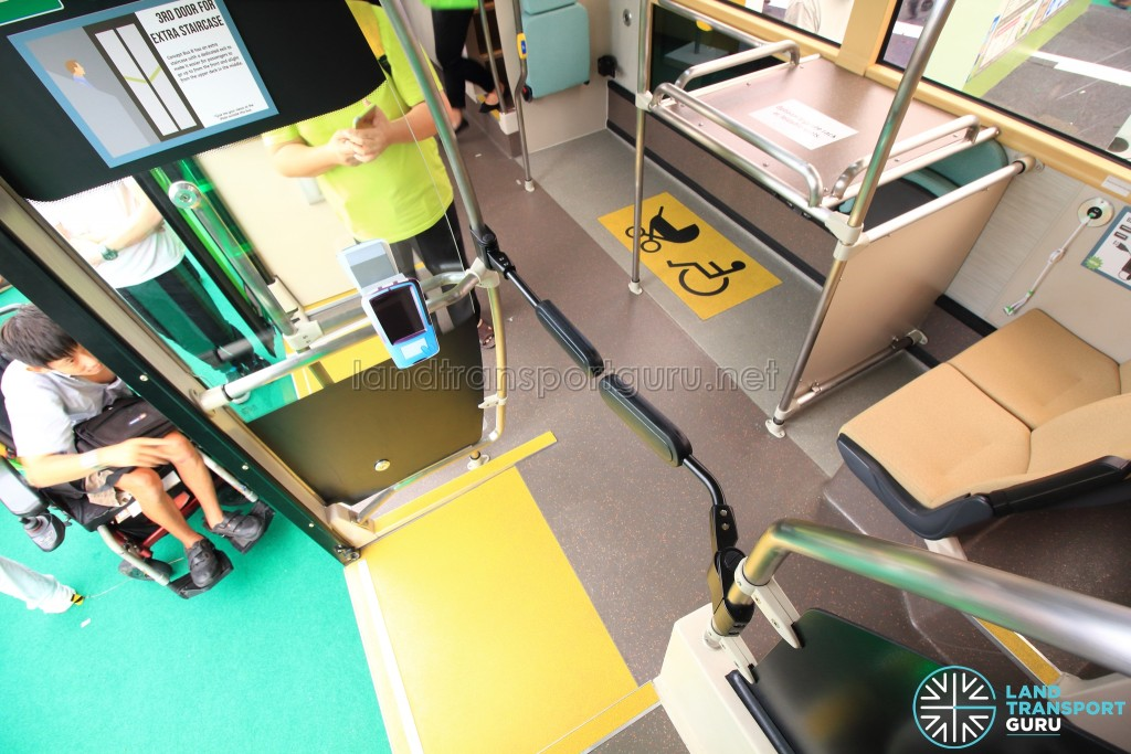A set of spring barriers allows passengers descending the rear staircase to re-enter the lower deck while preventing lower deck passengers from using the staircase promoting a linear flow of commuters within the bus.