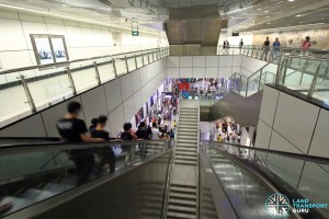 Dhoby Ghaut MRT Station - NEL Transfer Hall at B3, with long escalators descending to platform level at B5