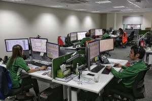 Service controllers at the Bulim bus depot operating LTA's new CFMS - Straits Times Photo