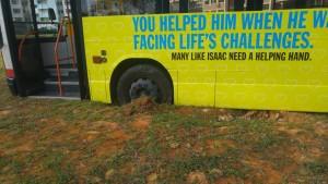 SMRT bus stuck in soft ground. CNA Photo by Melissa Zhu.