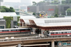 SMRT C151 train sets 027/028 and 037/038 coupled together at Jurong East Station