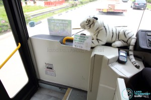 Stuffed tiger at the entrance of the Mandai Express bus