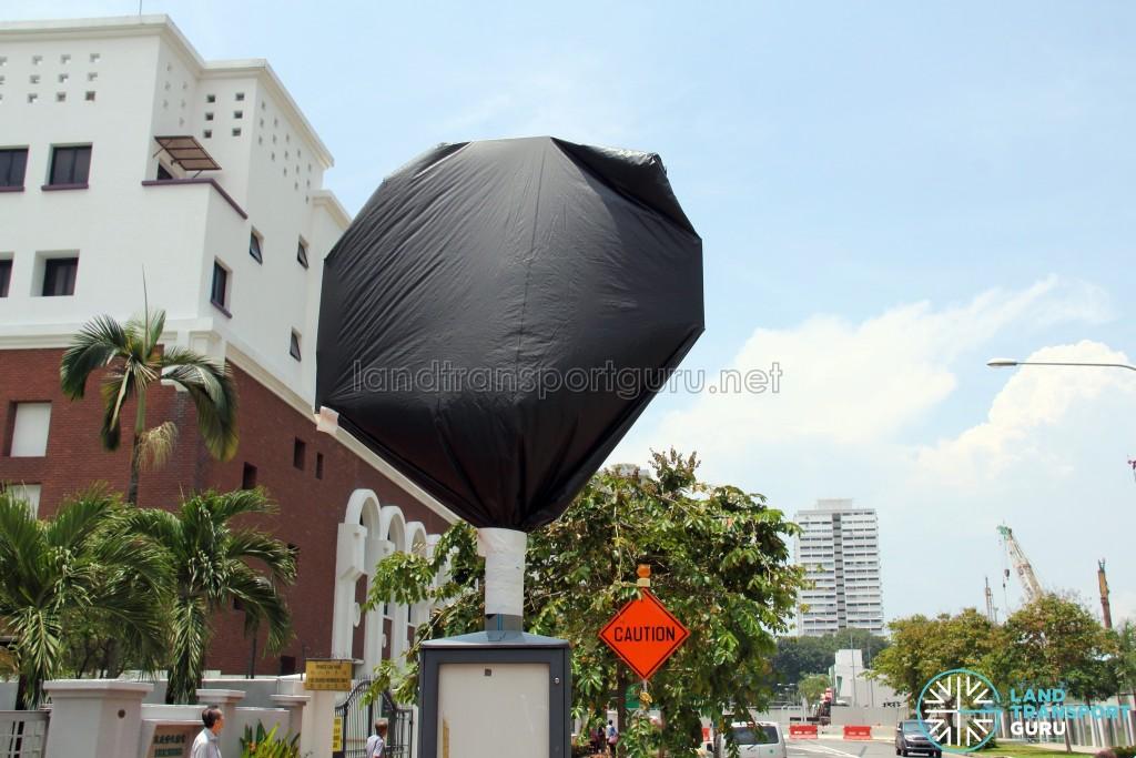 Covered bus stop pole at Bus Stop 92189 (Opp 112 Katong) along Joo Chiat Road