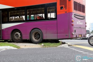 The bus fully mounted the kerb, damaging it in the process