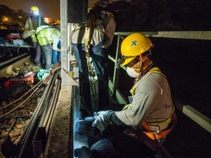Workers install lineside CBTC equipment during engineering hours (Photo: LTA)