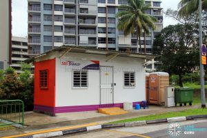 Taman Jurong Bus Terminal - Shipping container office and restroom, with adjacent portable toilet