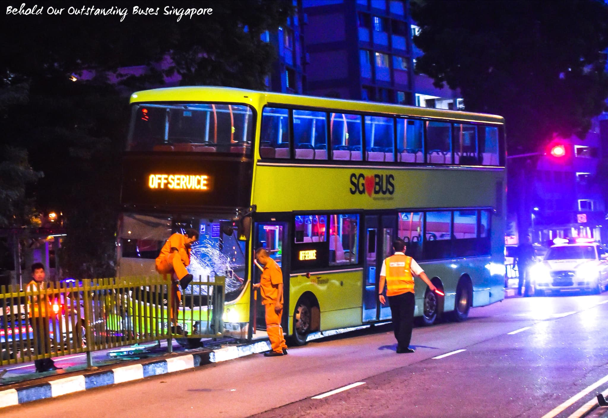 SBS Transit double-decker bus mounts road divider at Simei
